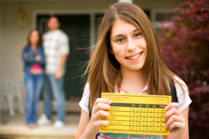 girl_holding_report_card
